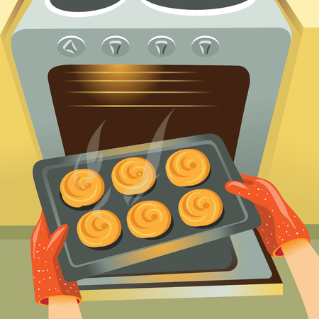 Image of the oven and the tray on which lie the hot buns