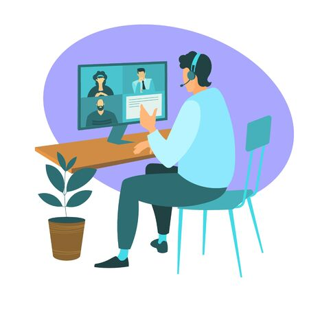 A man from home participates in a video conference with colleagues at work