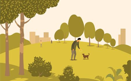 A man in a Park walks with a dog