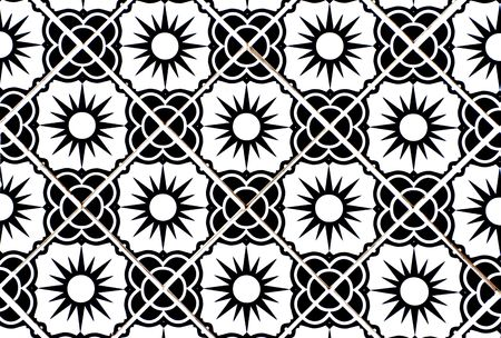tile grout: Ceramic tiles with flower and sun motif in black and white. Stock Photo