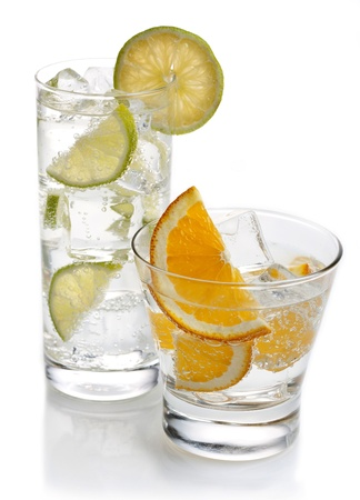 drinks with orange and a lime on a white background