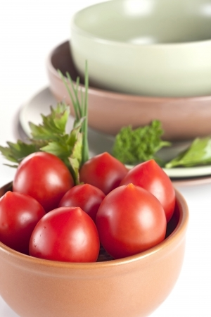tomatoes with parsley in a plate on a white background Stock Photo - 19728698