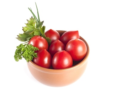 tomatoes with parsley in a plate on a white background Stock Photo - 19728686