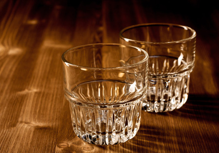 bar top: Two tumblers on a wooden bar top