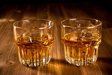 whiskey on the rocks: Two glasses of whiskey on the rocks