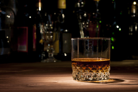 Glass of whiskey on a wooden table in the bar Stok Fotoğraf