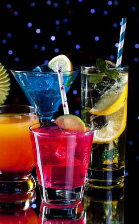 lounge bar: Variety of colorful cocktails over starry black background