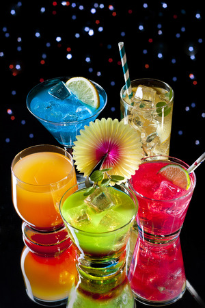 icecube: Variety of colorful cocktails over starry black background