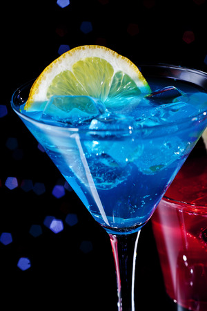 icecube: Two colorful cocktails over starry black background