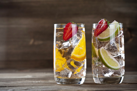 fruit in water: Three fruit cocktails on a wooden table