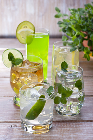 Cold drinks with fruits and mint on wood background Stok Fotoğraf