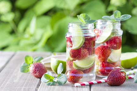 alcoholic beverage: Strawberry and lime lemonade in a mason jar