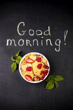 Healthy breakfast on a black background and a good morning text Stok Fotoğraf