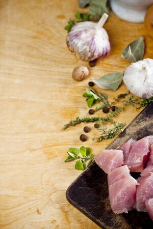 Layout of raw ingredients for fricassee including meat, herbs and spices with place for text