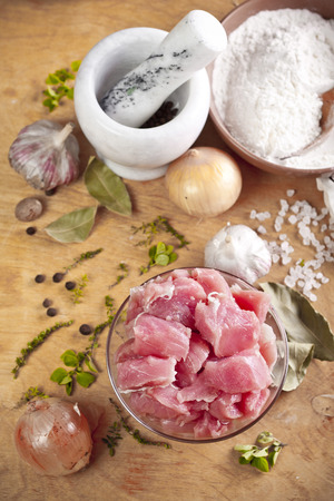 fricassee: Layout of raw ingredients for fricassee including meat, herbs and spices