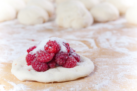 Stuffing homemade pies with raspberries Stok Fotoğraf