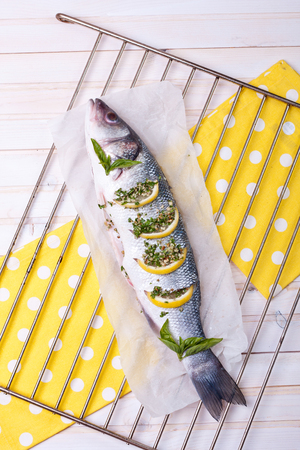 Raw gilthead with lemons ready to be grilled