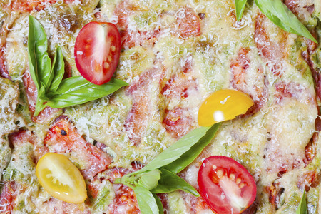 Vegetarian quiche with cheese, tomatoes and basil