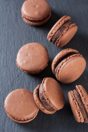 Chocolate macaroons on a natural stone surface Stok Fotoğraf