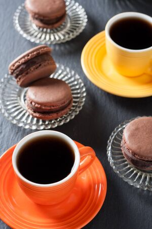 Chocolate macaroons and a two cup of coffee on a natural stone surface Stok Fotoğraf