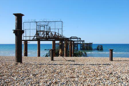 Rusting framework of a derelict pier