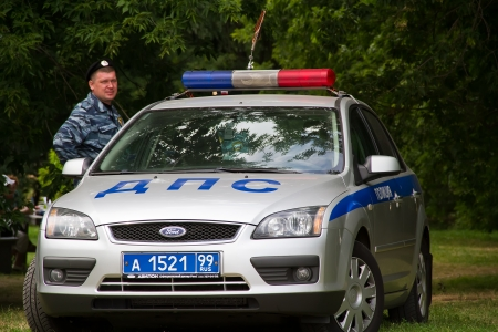 Russian police officer near the police car. Moscow 07.07.2012