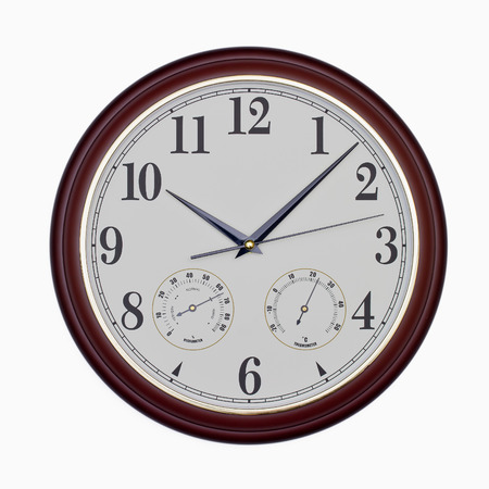 Quartz wall clock with hygrometer and thermometer isolated on white photo