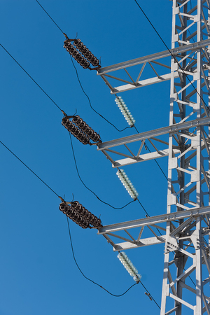 electric grid: Electric power lines on a blue sky background