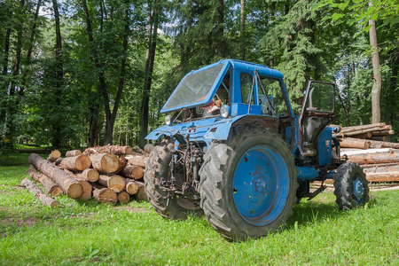 Small wheel tractor at a forest logging work. 写真素材