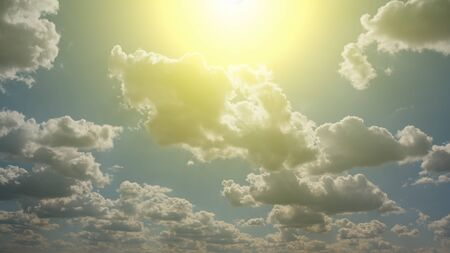 Blue sky with white clouds and sun. Natural background image