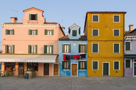 BURANO, ITALY - 07 DECEMBER, 2018: Colorful houses and landmarks on the island of Burano on the edge of the Venetian lagoon. Venice, Italy.
