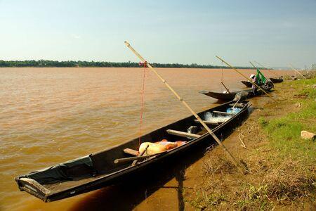 sculling: Padding boat at Maekhong river