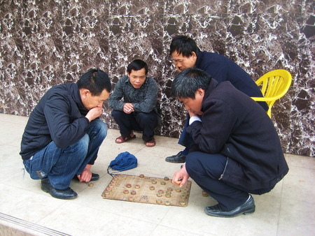Friends play Chinese chess together