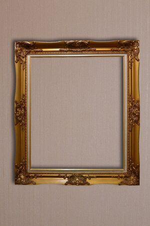 golden vintage frame isolated on wall photo