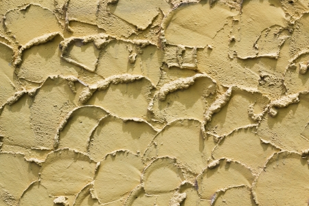 Old cement yellow wall texture photo