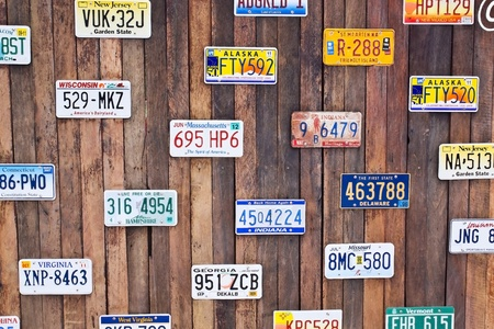 numberplate: License plate on old wood Editorial