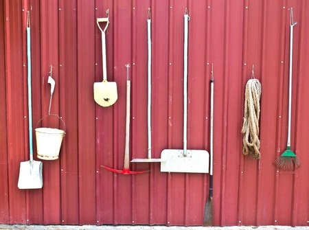 farm implement: Farm tools on red wall