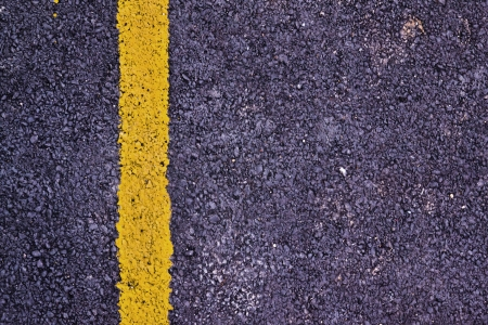 Yellow line on new asphalt detail Stock Photo - 22417572
