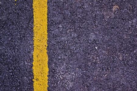 Yellow line on new asphalt detail Stock Photo - 22417572
