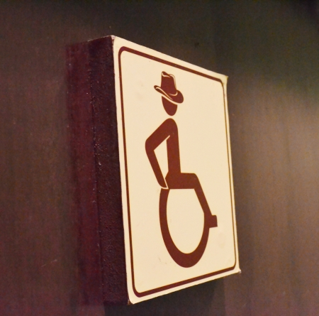 Bathroom signs for people with disabilities on wood wall photo
