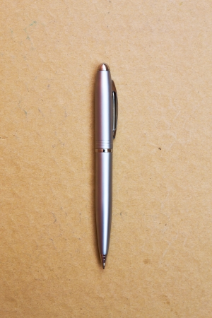 Pen on brown background photo