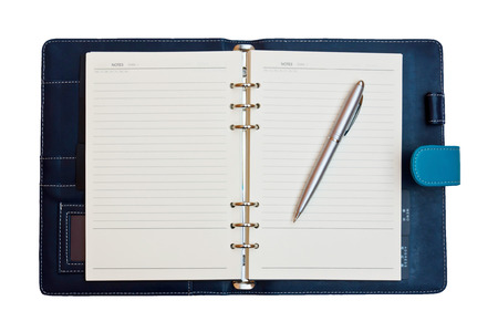 a leather notebook with spiral, pen and blank lined paper photo