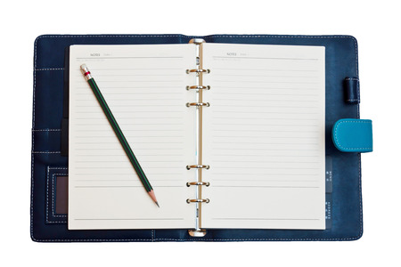 a leather notebook with spiral, pencil and blank lined paper photo