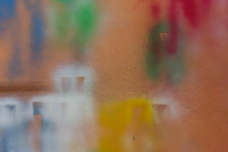Spray paint on orange wall. photo