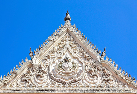 ornately: detail of ornately decorated temple roof in thailand