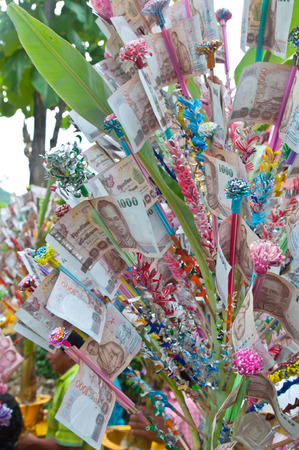 Thailand Banknotes people be combined in a religious ceremony. photo