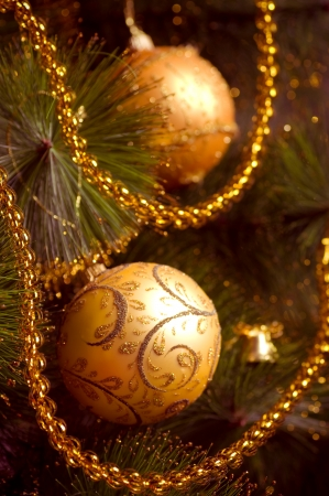 Beautiful color christmas decorations hanging on christmas tree with shiny glare photo