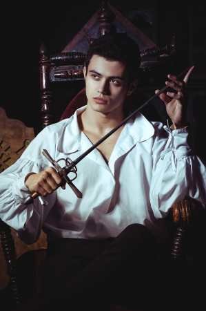 the historical: Portrait of a romantic man with a sword Stock Photo