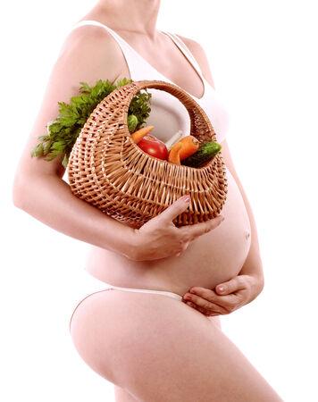 妊娠と栄養 - 野菜 iv バスケットと妊娠中の女性