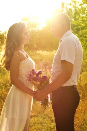Beautiful wedding couple in the garden photo